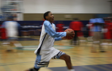 Senior Tim Patrick flies down the court at a home game.