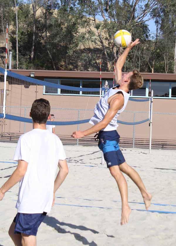 Junior Ben Lolly-Wilson jumps high to spike the competition.