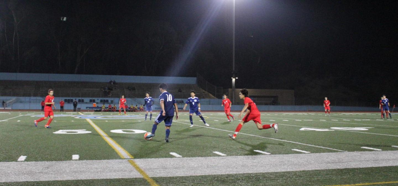 Senior Sage Corona passes the ball to a waiting teammate.