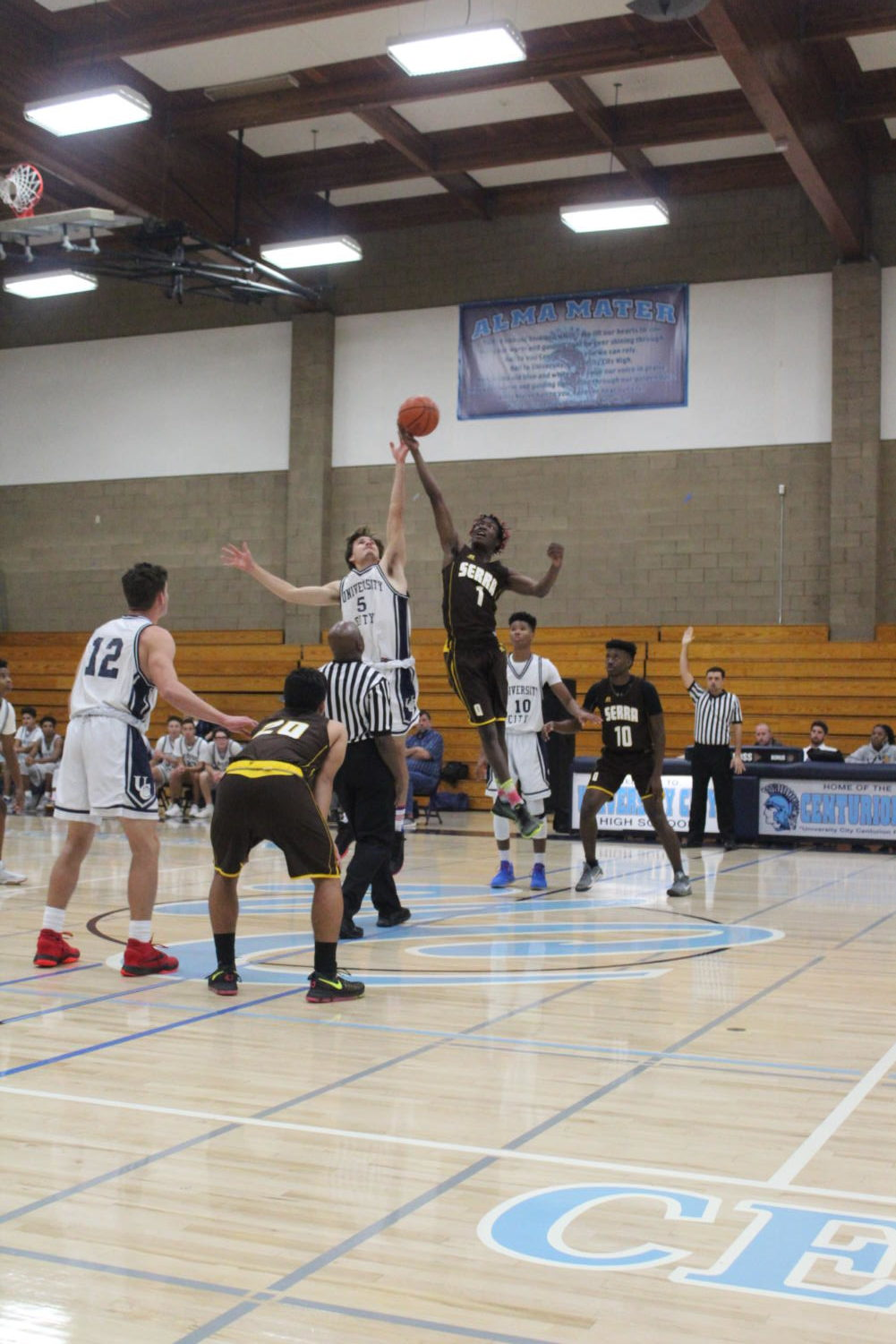 Junior Benito Hurtado goes up for the tip-off against Serra High.