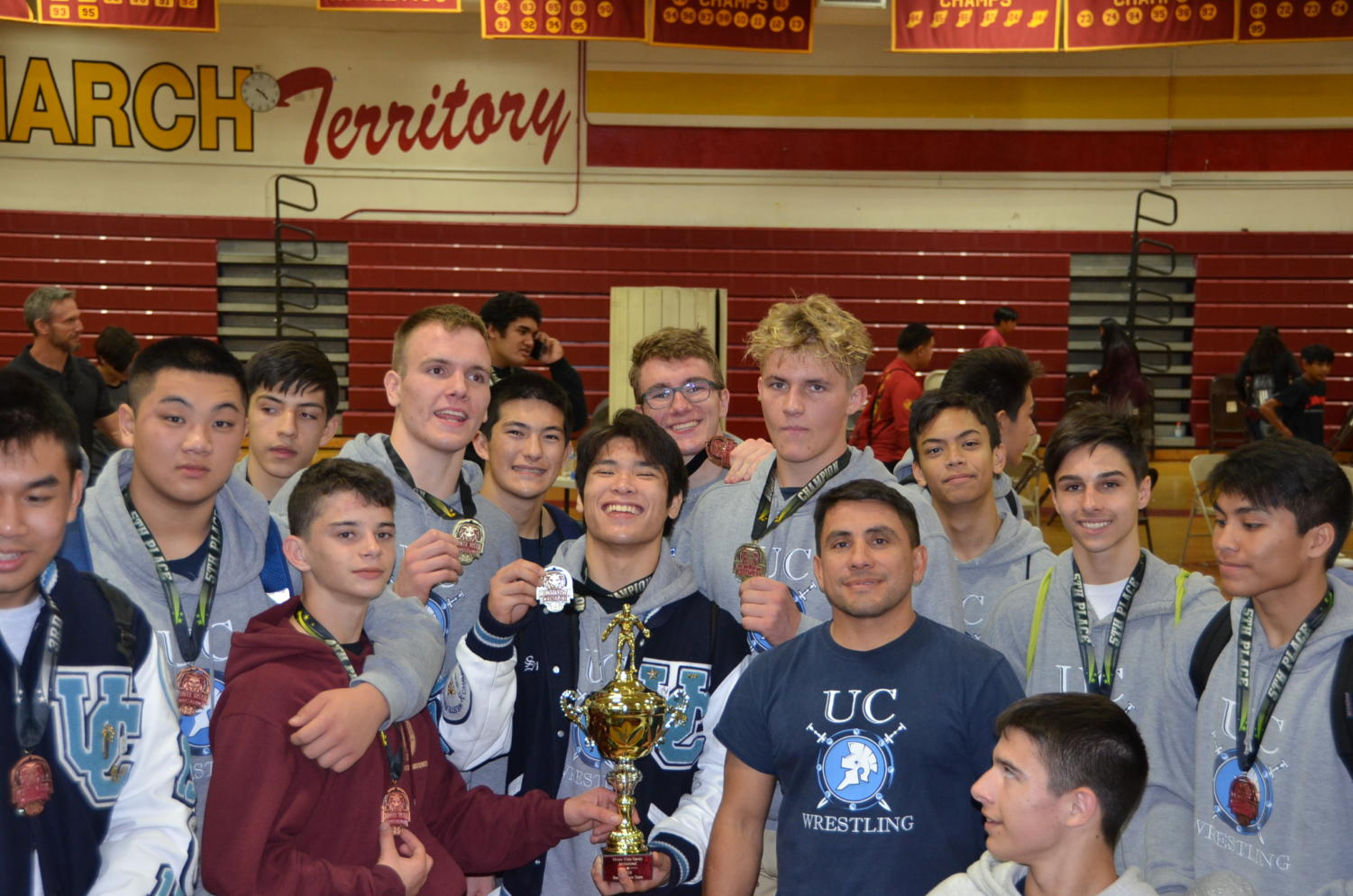 The UC High Wrestling Team celebrates their success after taking second in CIF team duels.