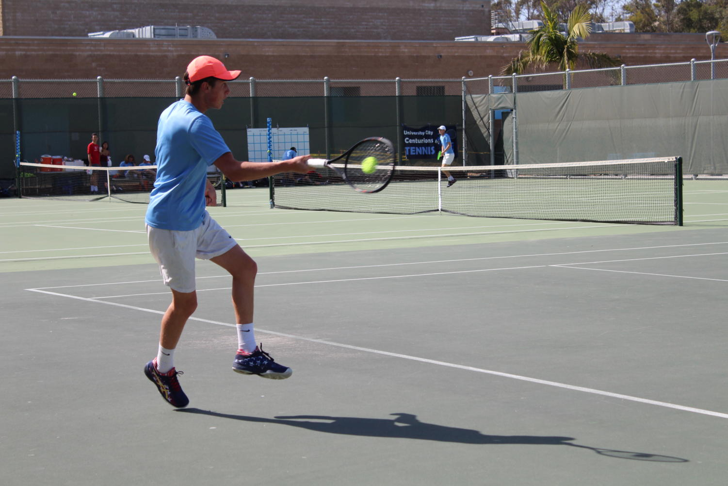 Junior Charlie Openshaw hits a forehand.