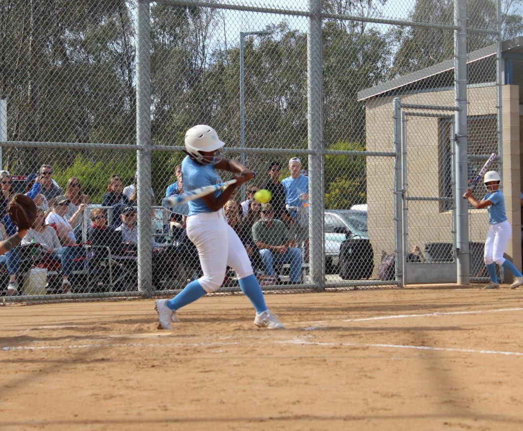 Sophomore JaLisa Morrow swings at the pitch.