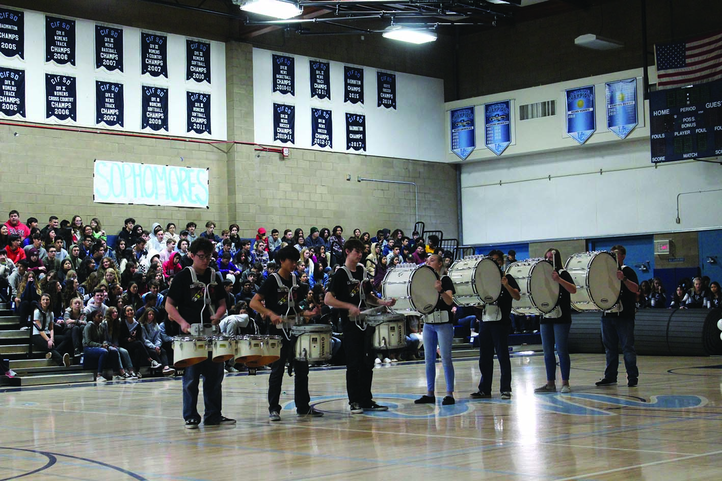 Fall Drumline Members Michael Haley, Alex Tong, Jeff Livers, Emily Pilkington, Anthony Dinh, Cassandra Bristol and Benji Davis, some of whom are in Winter Percussion, perform at the Winter Pep Rally.
