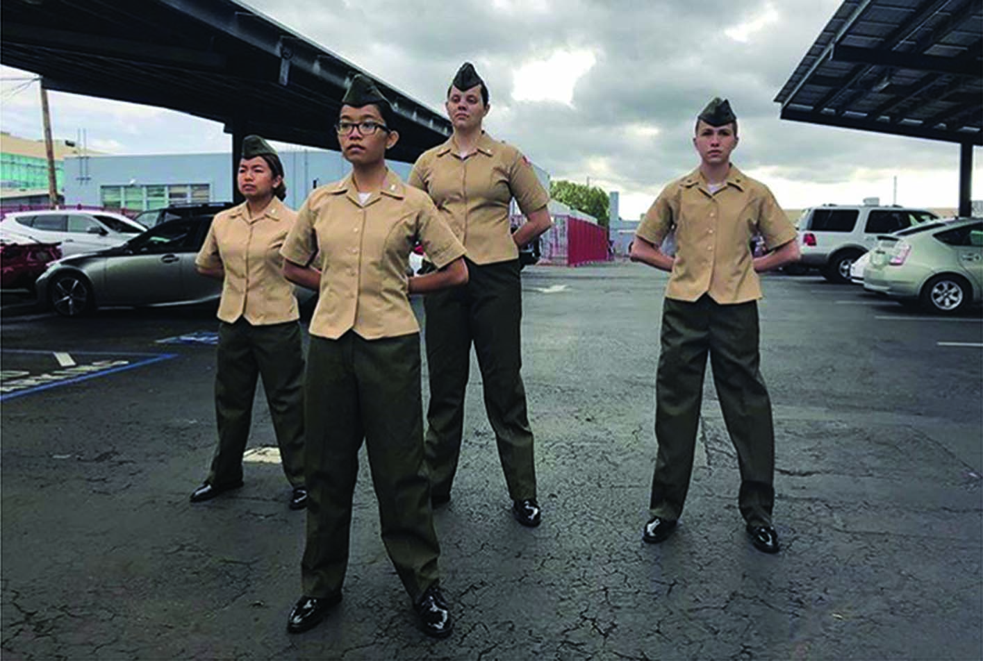 Sophomore Patricia Sourinphomy, Junior Natalia Trinh, Senior Rachel Bressler, Sophomore Rebecca Tanner (left to right) pose in their MCJROTC uniforms.