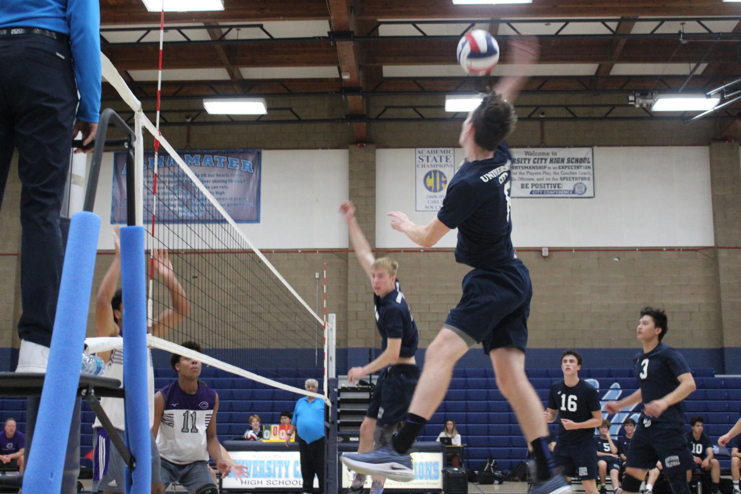 Senior Outside Hitter Connor Martin goes up for a kill on a set from Senior Setter James McMillan in a non-League match versus Carlsbad High.