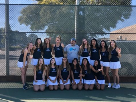 Last years Girls Tennis Team poses for a team picture.