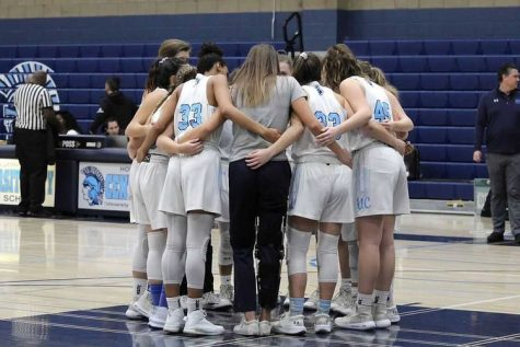 The 2019 Girls Basketball Team huddles before a game